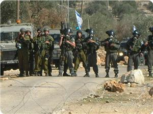 2012 File photo: Israeli forces attack unarmed marchers in Kafr Qaddum village